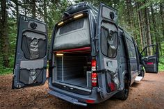 Outside Awesome Van; The Awesome Awe features interiors  such as custom upholstering, cabinet packages, load lights, sun shades, a ski rack, 12v refrigerators, a galley kitchen and much more.