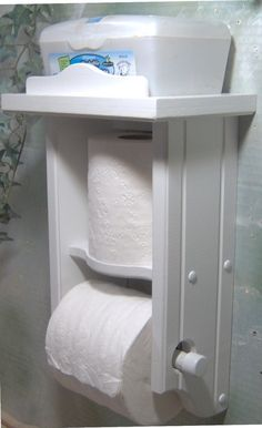 Nice solid wood product with a poly low luster white finish to keep it safe and very cleanable. The toilet paper holder dimensions are 8-1/2 wide by 15 tall and 5-1/4 deep. The bar removes from either the right or the left to reload the toilet paper. This is a JLJ Design and retails for
