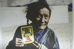 A picture of a nomad with a photo of His Holiness the 14th Dalai Lama, Chang Tang U-Tsang province 1995