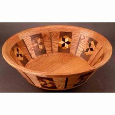 Winchester Woodworks creates this Wood Bowl. Now known for his focus on polychromatic segmented woodturning, Alan Davis' latest series involves the use of native hardwoods, (cut from his own 10-acre N