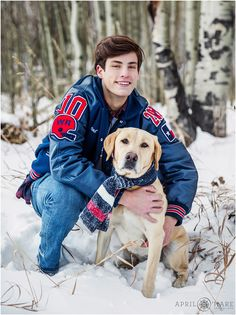High School Senior is photographed in the snow with his golden retriever dog in a snowy aspen grove during winter in Colorado mountains. - April O'Hare Photography http://www.apriloharephotography.com