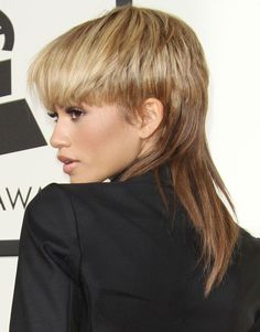 Zendaya teams her new mullet hairstyle with DSquare2 tuxedo suit at the 2016 Grammy Awards in Los Angeles on February 15, 2016