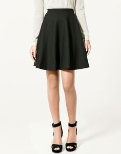 (a-line skirt)  look taller: Stick with skirts and pants that keep your legs looking balanced. Think A-line skirts and boot-cut jeans. Styles that flare out at the knee or lower leg help balance out the natural width of your hips. Tapered styles may make you look top heavy which, in turn, can make your legs look shorter. Shorter-looking legs may make you look shorter overall.