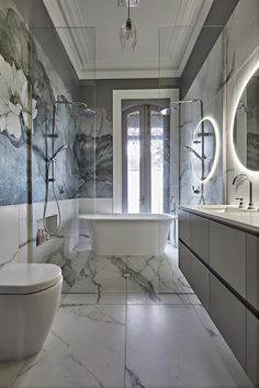 This main bathroom takes grandeur to a whole new level. Unique floral wallpaper gels beautifully with the textured veins of marble to achieve stunning finish. Two twin showers and freestanding bath create a decadent wet zone. Reece Bathroom, Tv In Bathroom, Grey Bathroom Tiles, Art Deco Bathroom, Bathroom Wallpaper, Bathroom Colors, Bathroom Interior, Bathroom Ideas, Bathroom Paneling