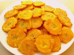 """""""Tostones"""" Fried Green Plantains. If you add a little bit of """"mojito"""" on top? Yummmy!!"""
