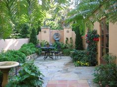 Superb Garden Courtyard Ideas in Patio Mediterranean design ideas with birdbath cafe furniture climbing plants courtyard french
