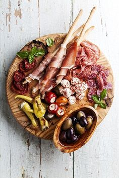 An antipasto platter balances savory and salty flavors; try pairing marinated…