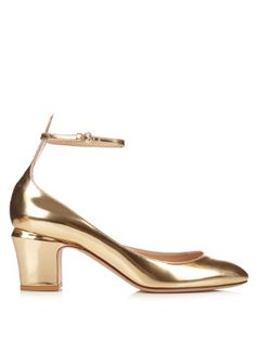 In gleaming gold leather, this is Valentino's most glamorous take on its classic Tango pumps. They have a curved-square toe to elongate the leg, as well as a thin buckle-fastening strap to frame the slimmest part of the ankle.