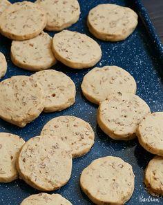 Maple-Pecan Icebox Cookies Recipe - PureWow Icebox Cookie Recipe, Icebox Cookies, Cookie Recipes, Pecan Recipes, Bar Recipes, Cookie Ideas, Yummy Recipes, Walnut Cookies, Crack Crackers