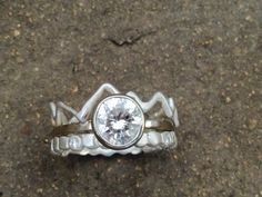 Diamond bezel set ring in White Gold and Sterling silver