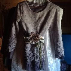 Multi layer chiffon tunic Light and dark lace and chiffon. Fits a medium or a large.  Bought and not worn. No tags. Belt not included. Tops Tunics