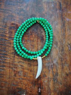 Jade Horn Necklace, $35 teenyandfree.etsy.com