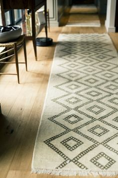 Loving the neutral palette and geometric patterns on this runner. Do it in Dark brown, not so that it reads black but still reads brown. Possible wall to wall.