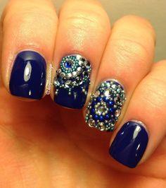 dark blue nails with rhinestone nail art