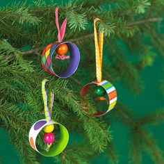 Paper Ring Christmas Ornaments     Get the kids to help make these simple and colorful ornaments. Overlap the ends of  1-1/4x7-inch-long strips of double-sided cardstock using a glue stick to secure the rings. Punch a hole for the hanger at the overlap. Make small loops with narrow ribbon, slip both ends through the hole, slip on chunky wooden beads, the knot the ends of the ribbon.