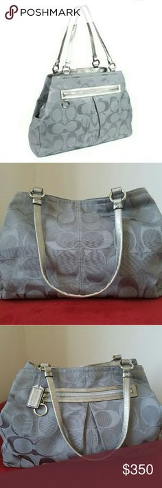 """COACH GABBY GREY/PURPLE XL TOTE ✴✴STUNNING✴✴  Grey/Silver/Purple Gabby Extra Large Tote!!!  Brand new, has only been used twice!!! Meticulously clean inside and out!!!  Classically designed and meticulously crafted, Coach has set an iconic standard for American luxury since 1941. Utilitarian hardware and bright colors revolutionized their product design.  17.25"""" (W) x 13"""" (H) x 5"""" (D) 9.75"""" Silver drop handles  Silver tone hardware with dog-leash closure Coach Bags Totes"""