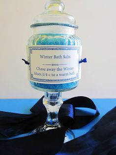 Coarse sea salt, blue food coloring, and grapefruit essential oil.  Cute and cheap gift idea.