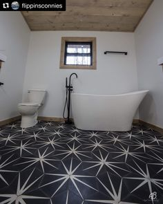 Our Trident Black cement tile makes a big statement in this bathroom renovation from This tile is in stock and delivers in about days. Free same or next day pick up available from our warehouse in Southlake, TX (DFW area). Half Bathroom Decor, Bathtub Tile, Bathroom Floor Tiles, Best Bathroom Designs, Small Bathroom Decor, Bold Tile, Bathroom Renovations, Cement Tile, Bathroom Design