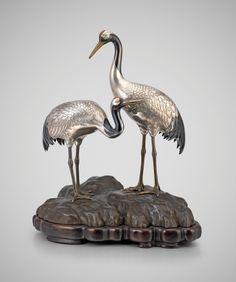 Yamakawa Kōji II (1860-1930) A Japanese study of silver cranes on a rock by Yamakawa Koji, Circa 1910 Okimono of a Pair of Cranes