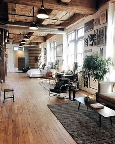 In love with these slim wooden floorboards! The whole space feels more like a barn conversion than a revamped industrial unit.