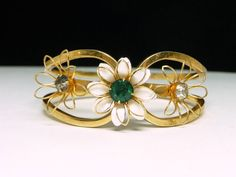 New Listings Daily - Follow Us for UpDates - Rainy Day Sale!!!  Vintage Hinged Floral Bracelet - White Enamel Flower with Green Rhinestone - Mid Century #Jewelry offered by #TheJewelSeeker on Etsy  Style:  Mid Century h... #vintage #jewelry #teamlove #etsyretwt #ecochic #thejewelseeker