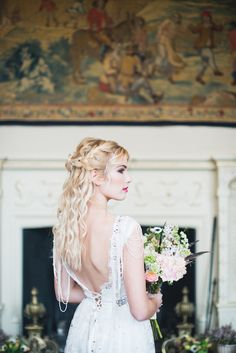 Loose and natural wavy hairstyle and beaded detailing on wedding dress   Laura Power Photography   see more on: http://burnettsboards.com/2014/07/eclectic-wedding-historic-manor-house/