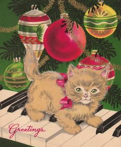 Vintage Christmas card - kitten on the piano keys