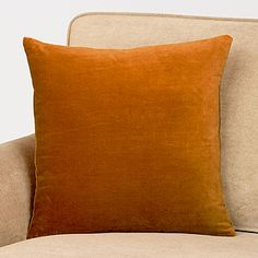 glazed ginger velvet pillow at Cost Plus, only $10...lumbar pillow is $15 + round bolster is $17  {basement?}
