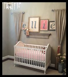 I know this is a crib but curtains on each side if bed and a quote or last name in the middle