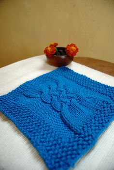 Ravelry: Braided Cable Wash Cloth pattern by Laura Woodward