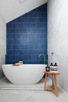 Gorgeous blue vertical subway tiles make a stunning feature wall in this master ensuite bathroom Neutral Bathroom, Grey Bathrooms, Beautiful Bathrooms, White Bathroom, Master Bathroom, Bathroom Trends, Bathroom Inspo, Bathroom Styling, Blue Feature Wall