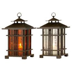 "Set of two iron candle lanterns with paned glass panels.    Product: 2 Piece lantern setConstruction Material: Iron and glassColor: Brown, clear, and orangeAccommodates: (1) Candle each - not includedDimensions: 15.75"" H x 9.5"" W x 9.5"" D each"