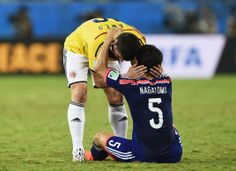 Colombia's James Rodriguez greets Japan's Yuto Nagatomo after Colombia won their 2014 World Cup Group C soccer match at the Pantanal arena in Cuiaba June 24, 2014. REUTERS/Dylan Martinez