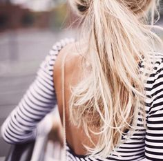 This low cut shirt shows off this adorable messy ponytail!