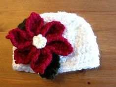 Poinsettia Pattern - free pattern, completely pops on the white Christmas hat the blogger made.