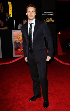 """Taylor Kitsch attend the premiere of Walt Disney Pictures' """"John Carter"""" on February 22, 2012 in Los Angeles, California."""