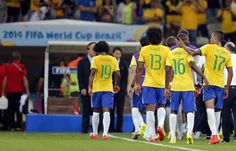Brazil players leave the pitch after the World Cup semifinal soccer match between Brazil and Germany at the Mineirao Stadium in Belo Horizonte, Brazil, Tuesday, July 8, 2014. Germany beat Brazil 7-1 and advanced to the final. (AP Photo/Frank Augstein)
