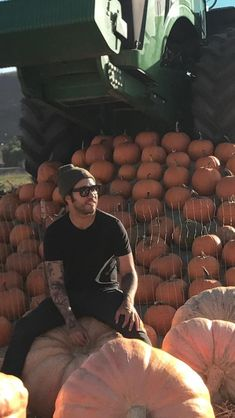 Pete and pumpkins that's it Pete sitting on Pumpkins and surrounded by pumpkins