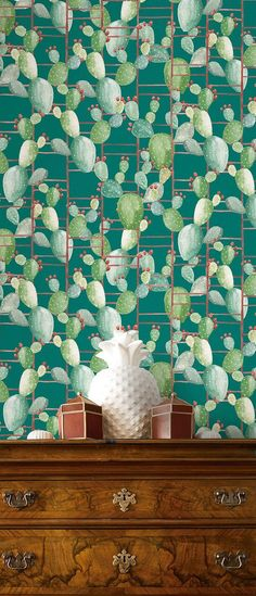 This super cute graphic cactus wallpaper will add some hipster style to your life - in a good way