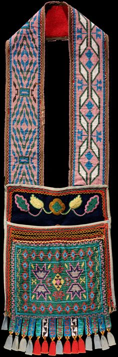 Anishinaabe bandolier bag  ca. 1870  Upper Great Lakes  Wool and cotton cloth, glass beads  87 x 26 cm  A. E. Brooks Collection  1/1125