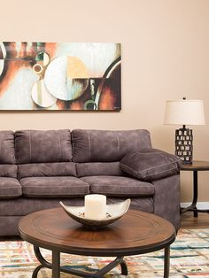 The Cody Chocolate Sofa by Washington Furniture has a versatile, transitional look enhanced by super-soft, chocolate polyester upholstery and bold contrast stitching. A pub black and plush, pillow top arms make this sofa extra inviting.