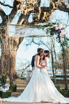 These two brides made it official beneath a beautifully decorated chuppah! {Flora + Fauna Photography}