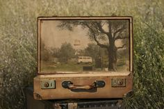 """In the nostalgic photo series """"Memory Suitcases,"""" Israeli artist Yuval Yairi painted faraway destinations on to old suitcases and then photographed the Collages, Collage Art, Vintage Suitcases, Vintage Luggage, Art Altéré, Old Luggage, Assemblage Art, Art Google, Altered Art"""