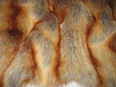 This luxurious faux fur fabric is perfect for Coats, Hats, Collars, Blankets, Pillows, Bed Spreads, Throw Blankets, Toys and many other projects. Also beautiful for photo props.  Above price is per yard! Multiple yards purchases will be shipped in one continuous piece. This Faux Fur Fabric is very soft and absolutely beautiful. It is a soft white color that really looks and feels like the real Red Fox fur. Made from 100% Synthetic (Modacrylic) Width: 60 - 70 No stretch Deep pile Pile Length…