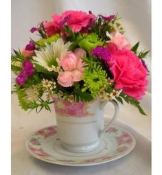 A bright arranement in a china tea cup is the perfect thinking of you gift! $36.90