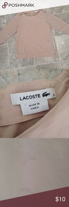 Lacoste Blouse Lacoste light pastel pink blouse. Has two stains on the front. That's why it's listed with this price. Other than that great condition. Lacoste Tops Blouses