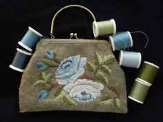 purse with crewel embroidery machine made