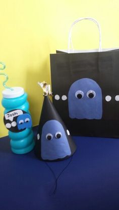 Pacman birthdays party. Homemade party hats, bags and cups