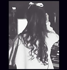 Ariana Grande hairstyle curled with bow