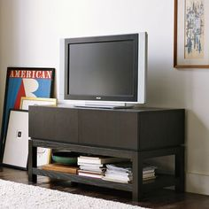 Parsons Media Small Console ...maybe too wide...$499 (*West Elm.. ***includes a built-in three-plug power strip that makes it simple to streamline cords and electronics.
